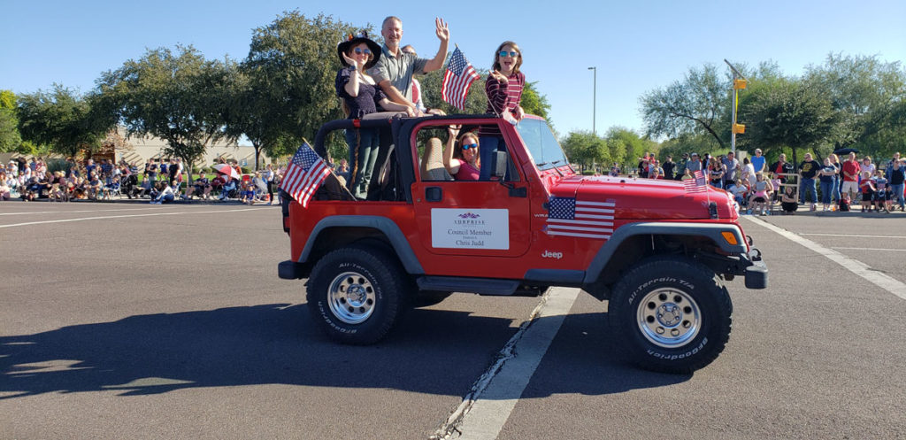 Councilmember Judd waves from a Jeep during the Veterans Day Parade in Surprise.