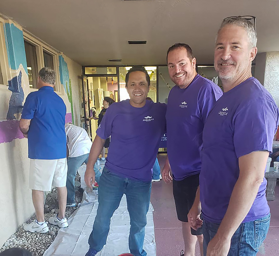 Councilmembers Sanders, Duffy and Judd volunteer for the Surprise Day of Service.