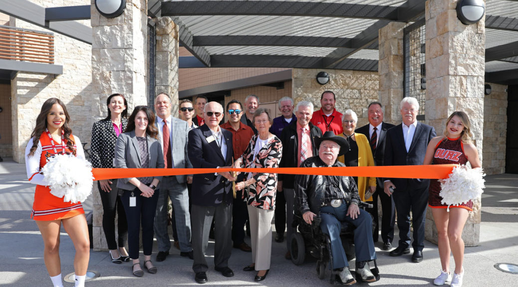 An orange ribbon is cut for the grand opening of the O'Dell Center at OUAZ.