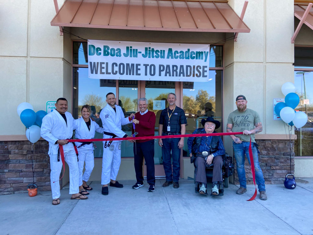 Mayor Hall cuts a red ribbon for the grand opening of De Boa Jiu-Jitsu Academy.