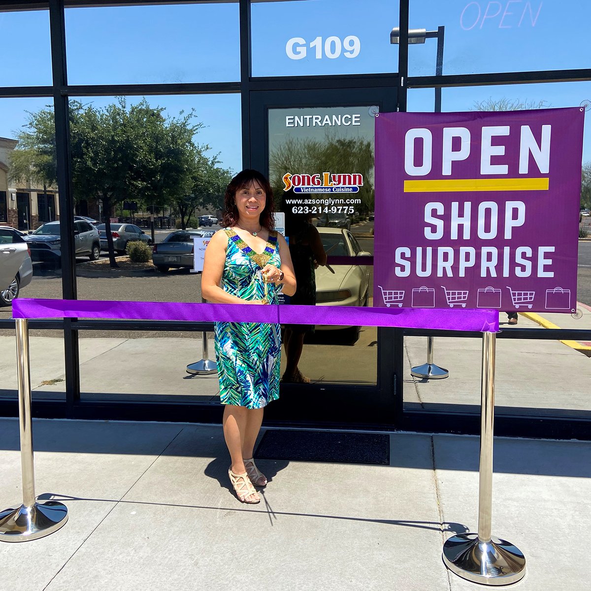 A purple ribbon is cut outside Song Lynn Vietnamese Cuisine for the business' re-opening.