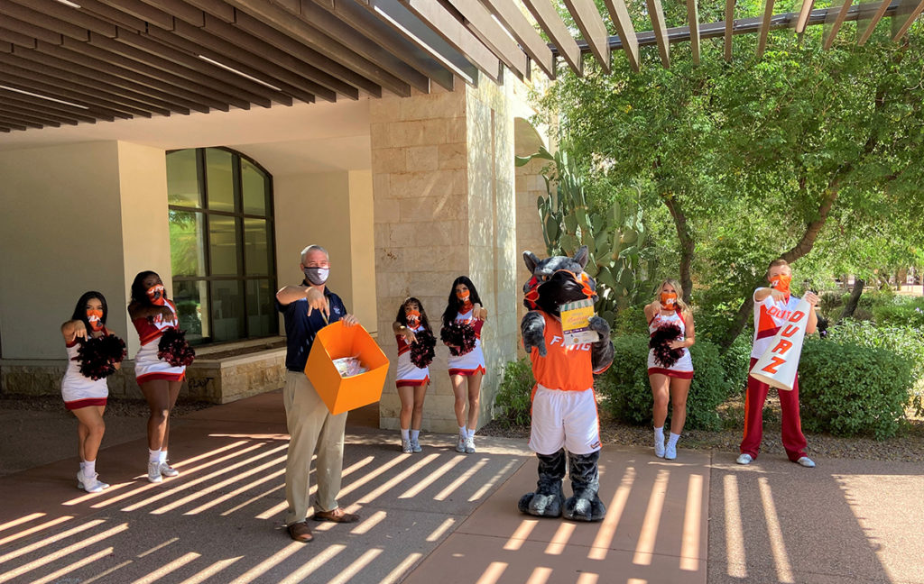 "Vice Mayor Judd, the OUAZ mascot and OUAZ cheerleaders showing their ""fangs""."