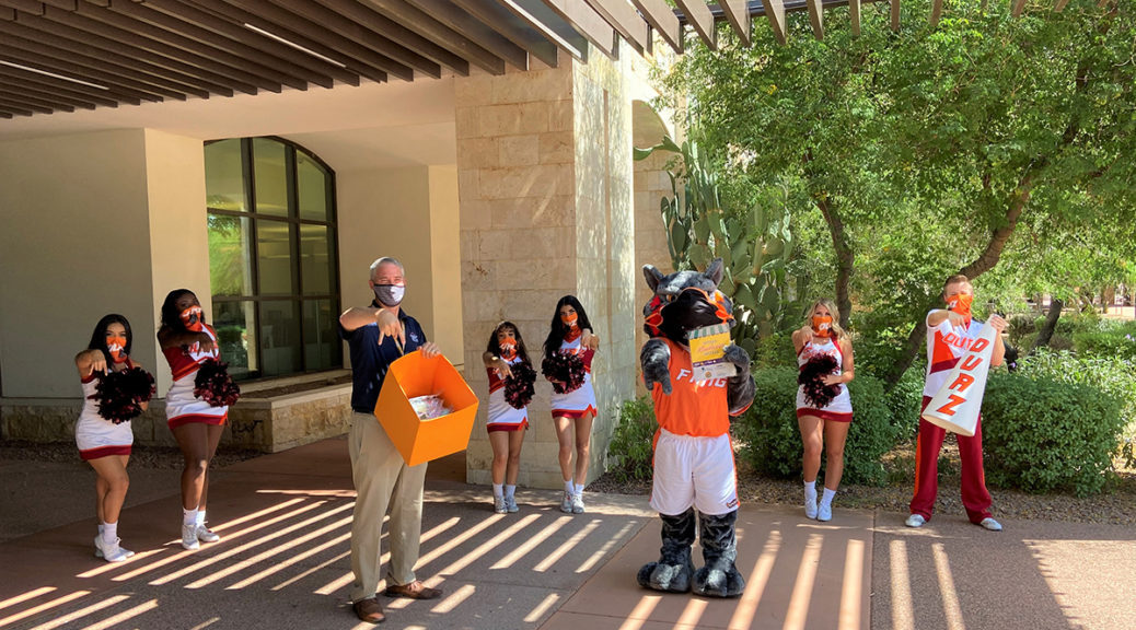 """Vice Mayor Judd, the OUAZ mascot and OUAZ cheerleaders showing their """"fangs""""."""