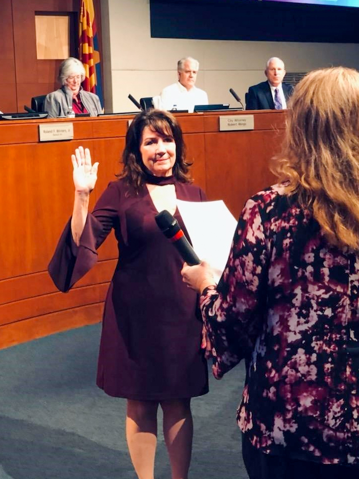 Associate Judge Catherine A. Gaudreau takes the oath of office.