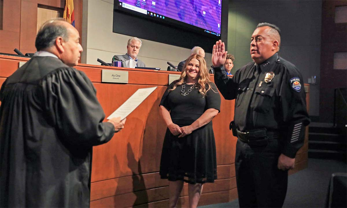 The Official Oath of Office is issues to Chief Piña by Judge Dominguez.