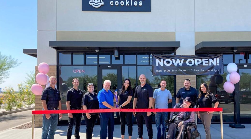 Mayor Hall, Councilmember Judd and Councilmember Winters join the owners of Crumbl Cookie to cut a grand opening ribbon.