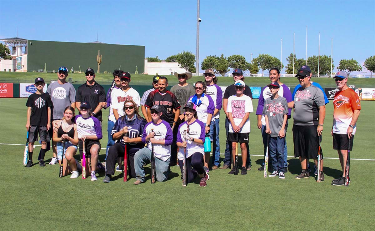 Charlie Woodland's friends, colleagues and family on the baseball field.